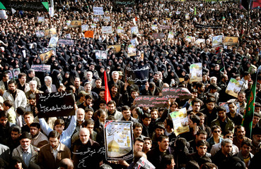 Iranian worshippers demonstrate in Tehran against the bombing of Shi'ite shrines in Samarra