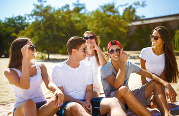 Group of young people having fun outdoors. Smile faces. Nice mood. Summer lifestyle