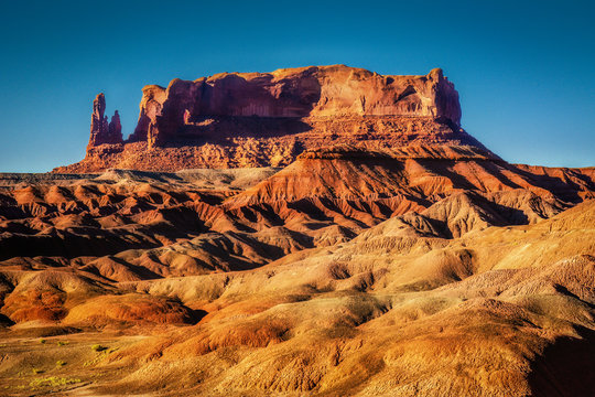 A Butte and Badlands at Sunset