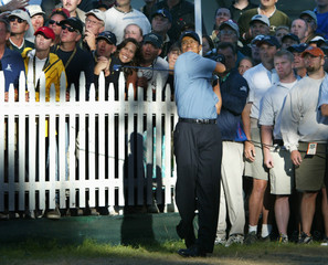 TIGER WOODS HITS SHOT ON 18TH HOLE DURING PGA CHAMPIONSHIP.