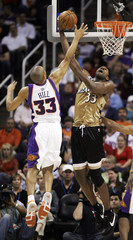 Washington Wizards Brendan Haywood scores while being guarded by Phoenix Suns Grant Hill during third quarter NBA basketball action in Phoenix