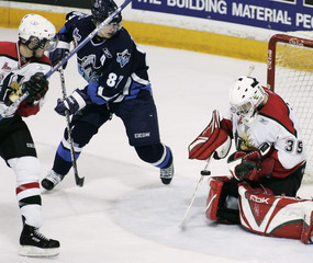 Rimouski's Sidney Crosby fires a shot on goal.
