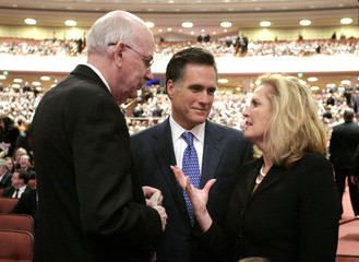 Republican presidential candidate Mitt Romney and his wife Ann chat with Senator Robert Bennett at the funeral of Gordon B. Hinckley