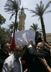 Mourners carry the coffin of Marwan, the son-in-law of former Egyptian President Nasser, during his funeral in Cairo