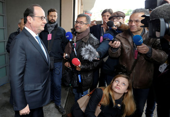 French President Francois Hollande leaves a polling station during the second round of 2017 French presidential election, in Tulle