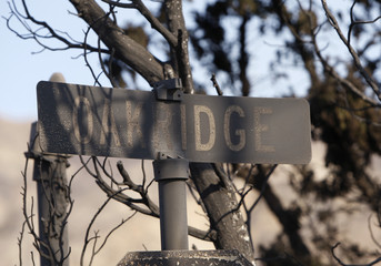 Burned street sign is seen at Oakridge mobile home community in Sylmar area of Los Angeles