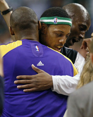 Boston Celtics' Pierce hugs Los Angeles Lakers' Bryant, with Celtics Garnett in the background, prior to Game 1 of the NBA Finals basketball championship in Boston