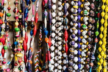 different colorful handmade beads at african flea market