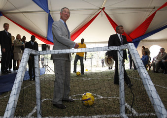 Britain's Prince Charles stands near soccer ball at King's House in Kingston
