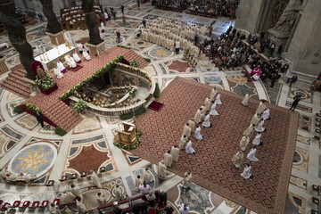 Newly ordained priests are seen as Pope Francis leads a mass in Saint Peter's Basilica at the Vatican