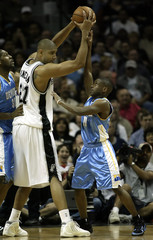 Spurs Duncan holds ball away from Nuggets Boykins during first half action in Game Two in San Antonio.
