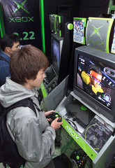 GAME ENTHUSIASTS PLAY MICROSOFT'S XBOX AT PRESALES EVENT IN TOKYO.