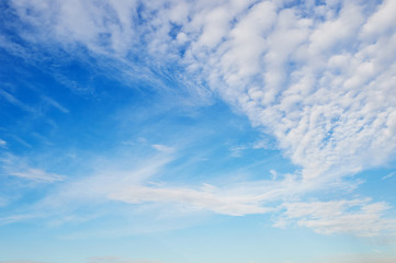 Beautiful blue sky with fluffy clouds.Texture natural