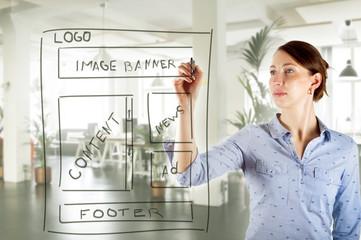 web designer drawing website development wireframe