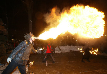 RUSSIAN FIRE EATER OF THEATRE OF FIRE PERFORMS DURING CHRISTMAS SHOW IN CENTRAL MOSCOW.