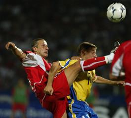 TURKEY'S KERIMOGLU KICKS THE BALL OVER MOLDOVA'S CRESSENCO IN THEIRFRIENDLY SOCCER GAME IN ANKARA.