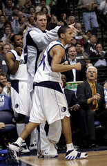 Mavericks guard Harris celebrates with forward Nowitzki after Harris hit a lay up and drew a foul in Dallas