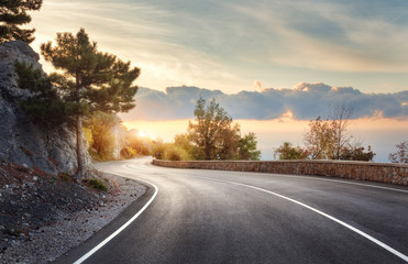 Photo sur Plexiglas Miel Asphalt road. Landscape with rocks, sunny sky with clouds and beautiful mountain road with a perfect asphalt at sunrise in summer. Vintage toning. Travel background. Highway in european mountains
