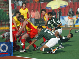 Pakistan's Shabbir Hussain and Shakeel Abbasi unsuccessfully attempt to score against Spain in Lahore.