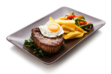 Grilled beefsteak with french fries and egg