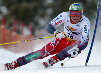 PALANDER OF FINLAND SKIS TO THIRD IN FIRST HEAT OF GIANT SLALOM.