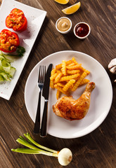 Roast chicken leg with french fries - restaurant