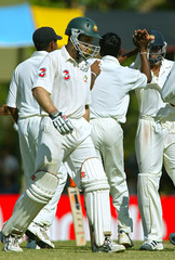 AUSTRALIA'S KATICH LEAVES THE FIELD AS SRI LANKAN CRICKETERS CELEBRATE TAKING HIS WICKET IN THE ...