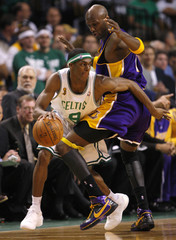 Celtics' Rondo is defended by Lakers' Odom in Game 1 of NBA Finals basketball championship in Boston