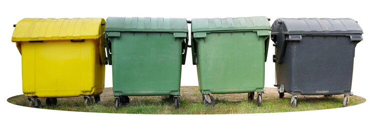 Four big isolated plastic  trash bin are located on a green grass.