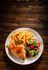 Roast chicken leg with french fries