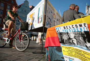 Protest poster against U.S. President Bush's visit to Germany is seen in Rostock