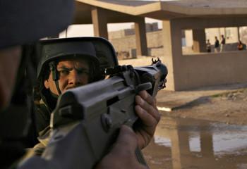 Kurdish Iraqi National Guard patrols through the Iraqi city of Mosul.