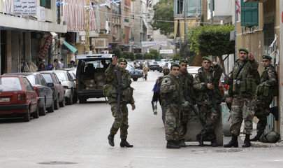 Lebanese soldiers take up position on a street in Beirut