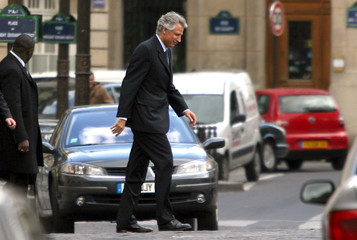 French PM Dominique de Villepin crosses a street as he leaves the National Assembly in Paris