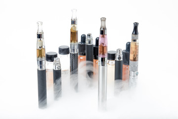 Electronic cigarettes with e-juice bottles with smoke