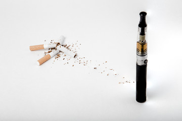 Broken tobacco cigarettes with modern electronic cigarette