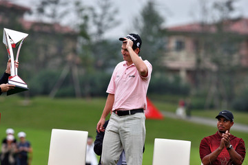 Briton David Howell receives trophy after winning Champions Tournament in Shanghai