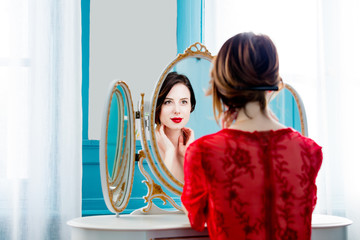 young woman looking at mirror