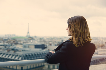 young woman looking at Paris
