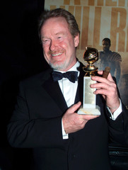 "Director Ridley Scott holds his trophy and a cigar after his film ""Gladiator"" was named Best Motion .."