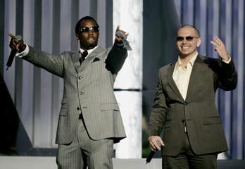 Sean P Diddy Combs and Pitbull present award at 2005 Billboard Latin Music Awards.