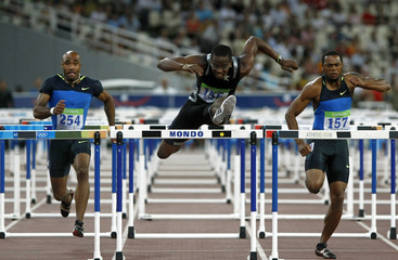 Cuba's Robles clears the last hurdle ahead of Moore and Payne of the U.S. in the men's 110 hurdles race at the IAAF Athens Grand Prix 2008