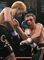 Czar Amonsot of Phillipines, battles it out against Michael Katsidis, of Australia, as Referee Jay Nady looks on during their WBO interim lightweight title fight at the Mandalay Bay Events Center in Las Vegas