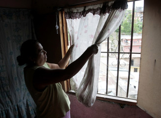 Fidelina Zepeda speaks to Reuters in her home after making tortillas to sell in her neighborhood of Santa Cecilia