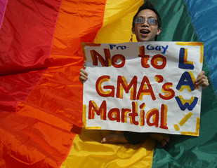 A Filipino gay protester shouts slogans denouncing President Arroyo's new policy during march in Quezon City north of Manila