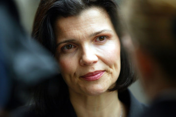 Ali Hewson, [the wife of U2 singer Bono], joined other protesters in Downing Street to hand in postc..