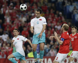 Turkey's Senturk heads the ball to score during their Euro 2008 soccer match against Switzerland in Basel