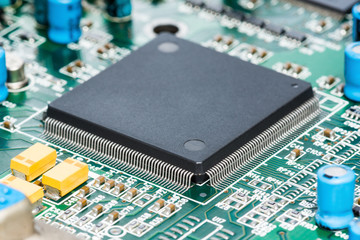 shallow dept of field of microprocessor and other component on green electronic circuit board