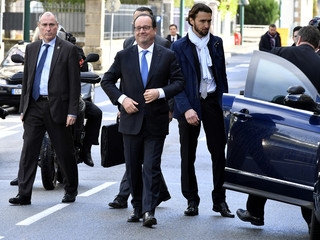 French President Francois Hollande walks in a street before visiting a polling station during the second round of the 2017 French presidential election, in Tulle