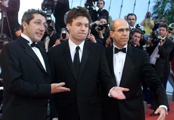 Voice actors Alain Chabat (L), Mike Myers (C) and DreamWorks producer Jeffrey Katzenberg (R) clown d..